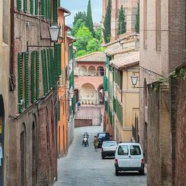 Walkway on in old town in Europe, Siena, Italy by Beautiful Things