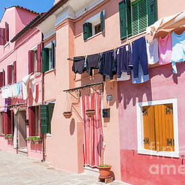 Washing drying outside coloured houses on the island of Burano in the Venice lagoon, Venice, Italy by Neale And Judith Clark