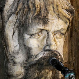 Water spouts from mouth of marble bearded face on a 1755 public fountain, Aix-en-Provence, France by Terence Kerr
