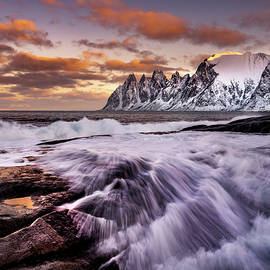 Wave on the coastline with the Devil's teeth rock formation in Senja, Norway. by Kristian Sekulic