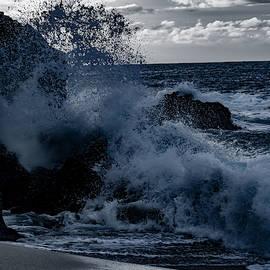 Waves crashing at Waimea Beach  by Jeffrey Raymond