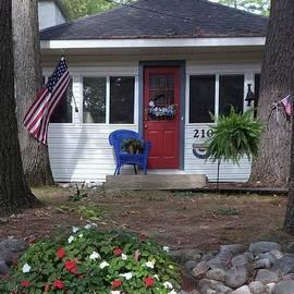 Welcoming and Patriotic Cottage Door by Barbie Corbett-Newmin