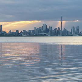 Well Placed Sunbeam - Toronto Skyline Highlighted Through Cloud Openings by Georgia Mizuleva