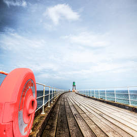 Whitby Pier, Moody Sky by Paul Thompson