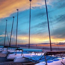 White and Blue Catamarans by Debra and Dave Vanderlaan