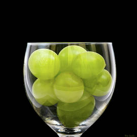 White Grapes in Wine Glass by Wim Lanclus