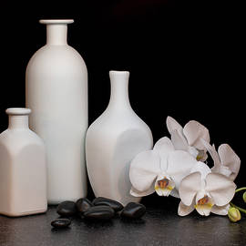 White Orchid and Bottles by Tom Mc Nemar