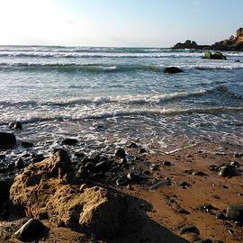Wild Algarve Coast in Warm Evening Light with Black Stones and Rocks by Aneta Soukalova