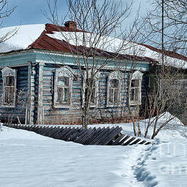 winter old log russian house covered with snow Russia by Tatiana Bogracheva