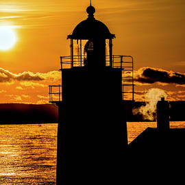 Winter Silhouette of West Quoddy Head Lighthouse by Marty Saccone