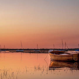 Wooden Boat at Sunset by Jim Key