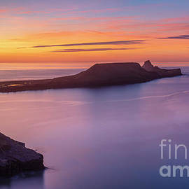 Worms Head Sunset, Rhossili, Gower coast, Wales by Neale And Judith Clark