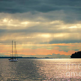 Yacht in the rays of the setting sun by Viktor Birkus