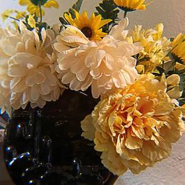 Yellow Flowers in Black Vase  by Janette Boyd