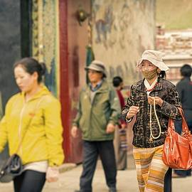 Young Woman Coming Out Of The Buddhist Monastery, Tibet, 64, 6-2016 by Vlad Meytin
