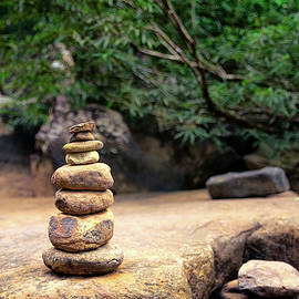 Zen Stones in balance with the nature in the woods by Sergio Florez Alonso