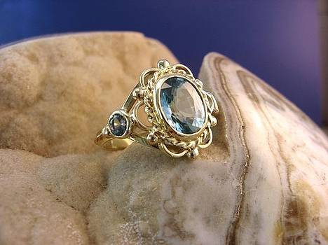 Big golden beauty with Aquamarine - ring by Leo Wildner
