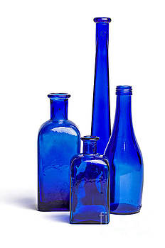 Composition of old blue bottles by Palatia Photo