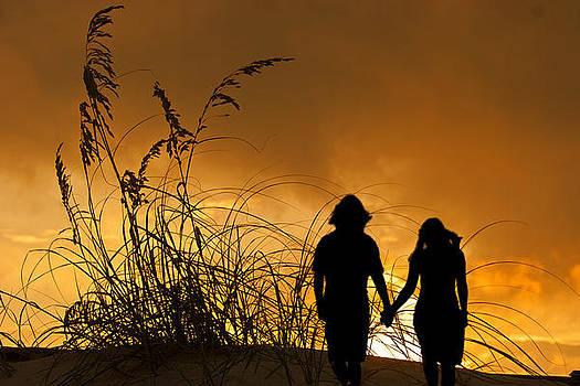 Couple on Beach at Sunset by John Hix