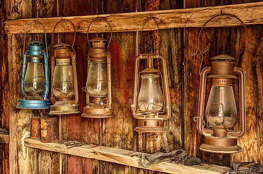 Old Western Lanterns Hanging In A Row by Kriss Russell