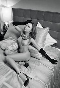 Portrait of Sexy Young lady posing at the bedroom by Anton Oparin