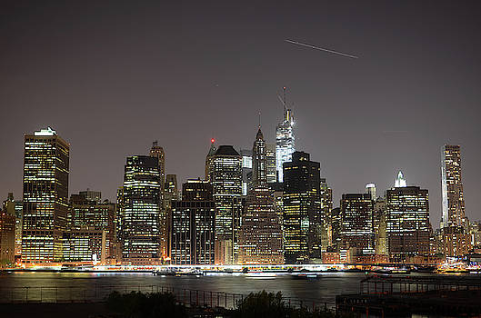 Night View Of Manhattan Skyline by Nano Calvo