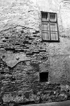 Aged wall with window by Peter Kallai