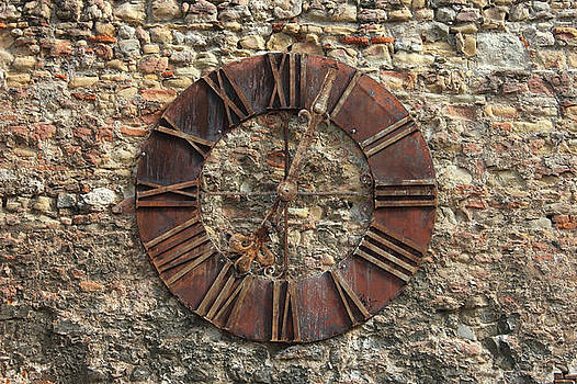 Ancient Clock Face on wall Background by Kiril Stanchev