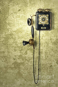 Antique Telephone On A Grungy Yellow Wall by Palatia Photo
