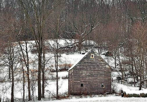 Barn in the snow by Chad Wilkins