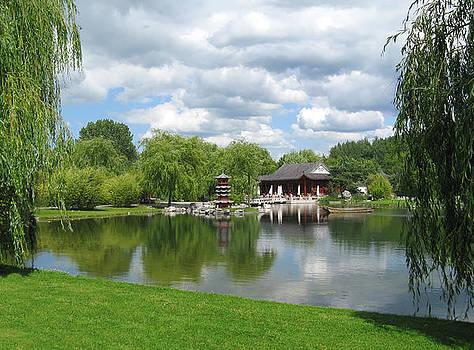 Chinese Tea Pavilion near the lake by Kiril Stanchev