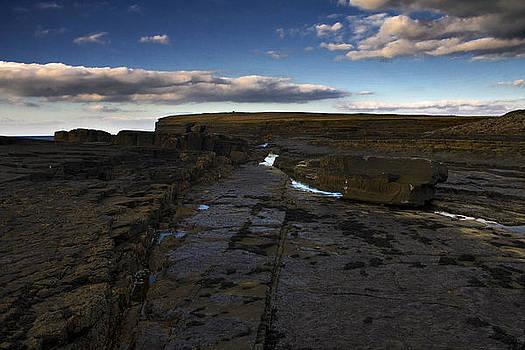 Cloud over rock2 by Tony Reddington