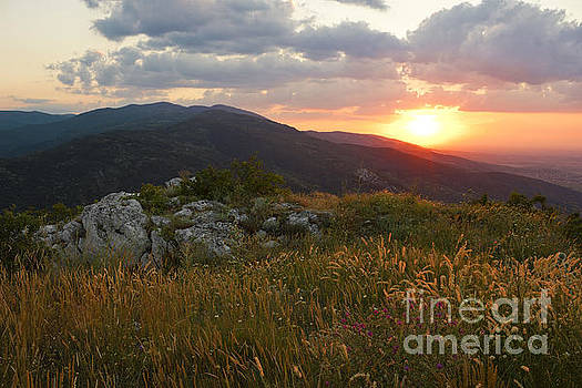 Colorful Sunset over the Mountain slope by Kiril Stanchev