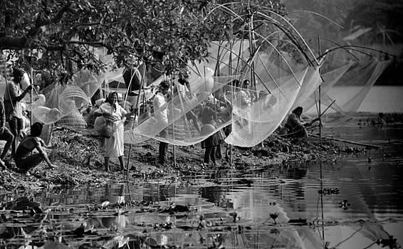 Community fishing by Samsul Huda Patgiri