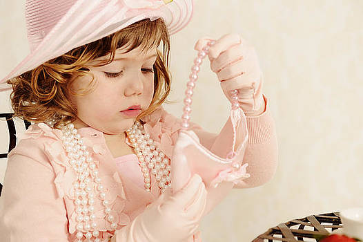 Delightful Little Girl Playing Dress Ups and Tea Party by Kriss Russell