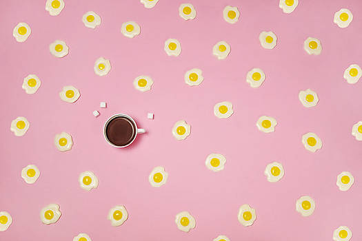 Eggs With Coffee Cup On Pink Background by