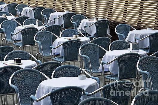 Empty restaurant seats and tables by Sami Sarkis