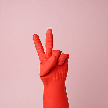 Hand In Red Rubber Glove Making Peace by