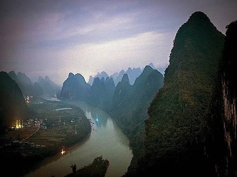 Karst Mountains Along The Li River by Tino Soriano