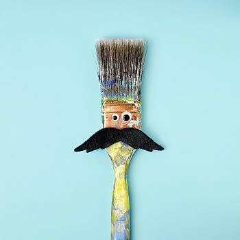 Mans Face Crafted Onto Paintbrush by