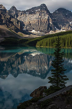 Mountain Reflections On Moraine Lake by Drew Rush