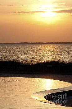 Ocean at pool at sunset by Cheryl Casey