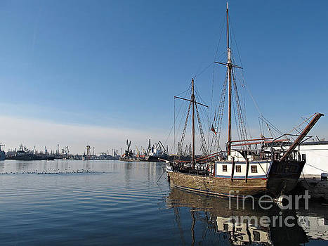 Old Ship in Calm Water Harbor by Kiril Stanchev