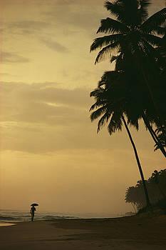 Person Walking Along A Beach In Sri by Steve Winter