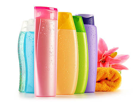 Plastic bottles of body care and beauty products by T Monticello