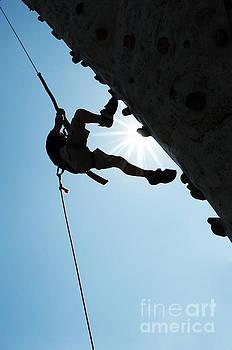 Silhouette of man climbing by Cheryl Casey