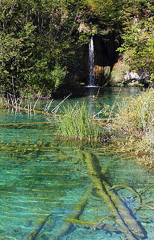 Small waterfall and an emerald colored lake by Kiril Stanchev