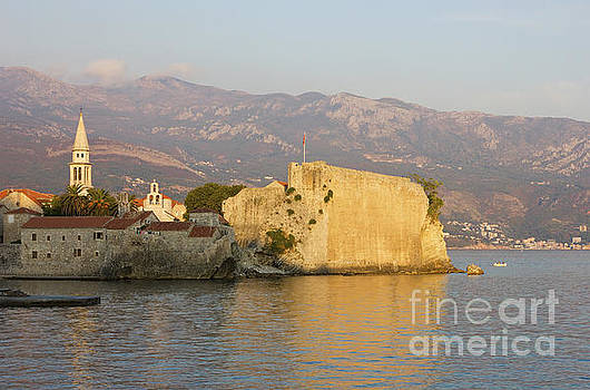 Sunset over old Town Budva in Montenegro by Kiril Stanchev