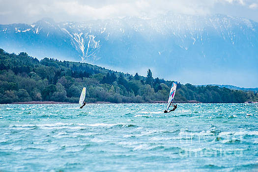 surfing in front of the Alps by Hannes Cmarits