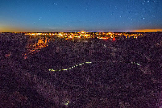 The Greenish Glow Of A Few Hikers Head by Peter Mcbride